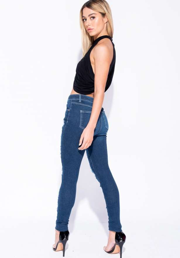 Multi Rip Distressed Mid Rise Skinny Jeans